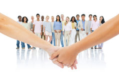 Multiethnic Group of People Smiling at a Couple Stock Photo