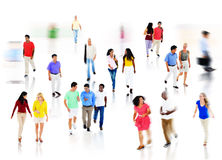 Multiethnic Group of People Walking in Blurred Motion Stock Photo