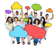 Multiethnic group of people wit Speech Bubbles Stock Images