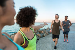 Multiethnic group of sport people warming up together Stock Photos