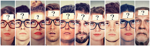 Multiethnic group of thinking people with question mark. Looking up royalty free stock photos