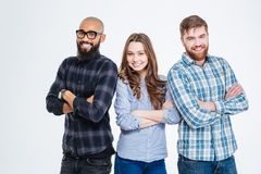 Multiethnic group of three confident smiling students Stock Images