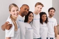 Multiethnic group of volunteers Stock Images