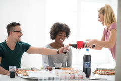 Multiethnic group of young people have a lunch break Royalty Free Stock Photography