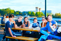 Multiethnic group of young people at lakeside park Stock Images