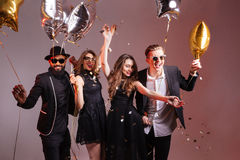 Multiethnic group of young smiling people dancing and having  party Stock Image