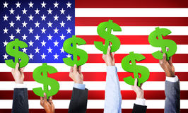 Multiethnic Hands Holding Dollar Signs Royalty Free Stock Images