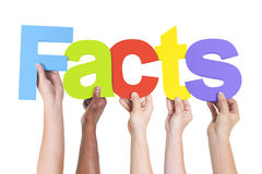 Multiethnic Hands Holding Text Facts Royalty Free Stock Images