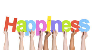 Multiethnic Hands Holding Text Happiness Stock Photo
