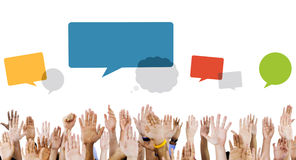 Multiethnic Hands Raised with Speech Bubbles.  Royalty Free Stock Photography
