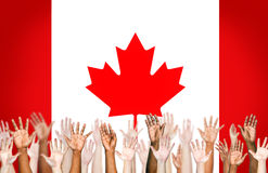 Multiethnic Human Hands with the Flag of Canada Royalty Free Stock Photography