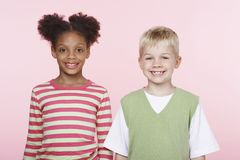 Multiethnic Kids Against Pink Background Stock Images