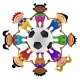 Multiethnic kids around a football Royalty Free Stock Image