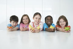 Multiethnic Kids Holding Various Fruits Stock Photos