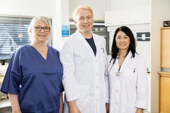Multiethnic Medical Team Smiling Together In Hospital. Portrait of multiethnic medical team smiling together in hospital stock photo