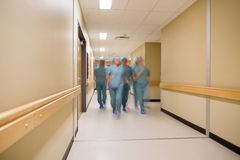 Multiethnic Medical Team Walking In Hospital Royalty Free Stock Image
