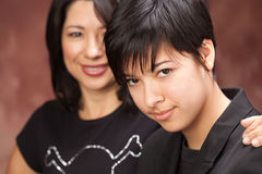Multiethnic Mother and Daughter Portrait Stock Images