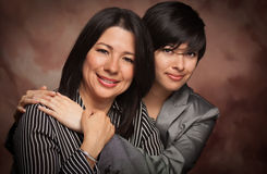 Multiethnic Mother and Daughter Studio Portrait Royalty Free Stock Photo