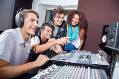 Multiethnic Musicians Mixing Audio Together At Table Stock Image