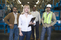 Multiethnic Operators In Newspaper Factory Stock Photo