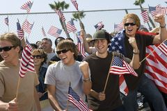 Multiethnic People With American Flags Stock Image
