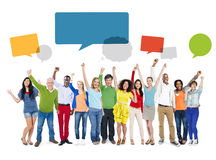 Multiethnic People Arms Raised and Empty Speech Bubbles Above Stock Photography