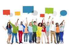 Multiethnic People Arms Raised and Empty Speech Bubbles Above Royalty Free Stock Image