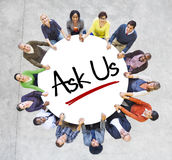 Multiethnic People in Circle with Ask Us Concept. Isolated on White Royalty Free Stock Photo