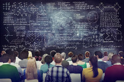Multiethnic People with Formula on Chalkboard Royalty Free Stock Photo