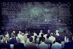 Multiethnic People with Formula on Chalkboard Royalty Free Stock Images