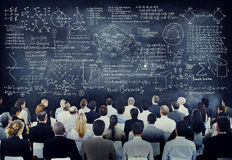 Multiethnic People with Formula on Chalkboard Stock Images