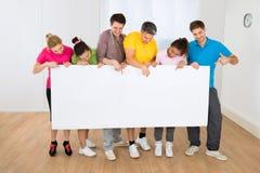 Multiethnic people holding blank placard Stock Image