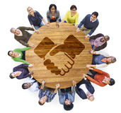 Multiethnic People Holding Hands with Handshake Symbol Royalty Free Stock Photo