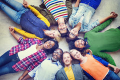 Multiethnic People Holding Hands and Lying Down Stock Photo