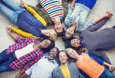 Multiethnic People Holding Hands and Lying Down royalty free stock images