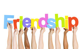 Multiethnic People Holding The Word Friendship Royalty Free Stock Images