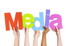 Multiethnic People Holding The Word Media Stock Images