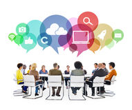 Multiethnic People in a Meeting with Social Media Symbols royalty free stock images