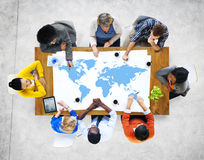 Multiethnic People Meeting with World Map. Multiethnic Group of People Meeting with World Map Stock Photo