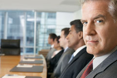 Multiethnic People In Row At Business meeting. Multiethnic business people sitting in row at conference meeting stock photo