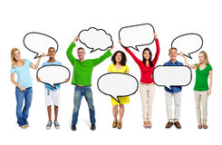 Multiethnic People with Speech Bubbles Royalty Free Stock Photos