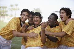 Multiethnic Soccer Players Celebrating Victory Royalty Free Stock Photo