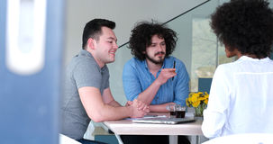Multiethnic startup business team on meeting Stock Photography