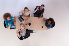 Multiethnic startup business team on meeting  top view Stock Photo