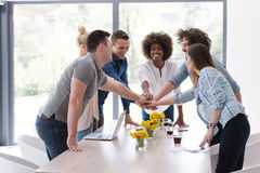Multiethnic startup Group of young business people celebrating s Royalty Free Stock Images
