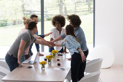 Multiethnic startup Group of young business people celebrating s Stock Image