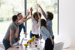 Multiethnic startup Group of young business people celebrating s Stock Photo