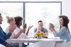 Multiethnic startup Group of young business people celebrating s Royalty Free Stock Image