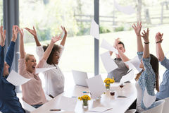Multiethnic startup Group of young business people throwing docu. Multiethnic Group of young business people throwing documents and looking happy while Stock Photos