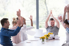 Multiethnic startup Group of young business people throwing docu. Multiethnic Group of young business people throwing documents and looking happy while Royalty Free Stock Photography